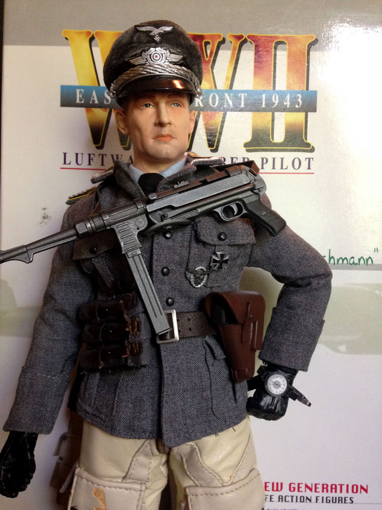 figure with mp40 across chest