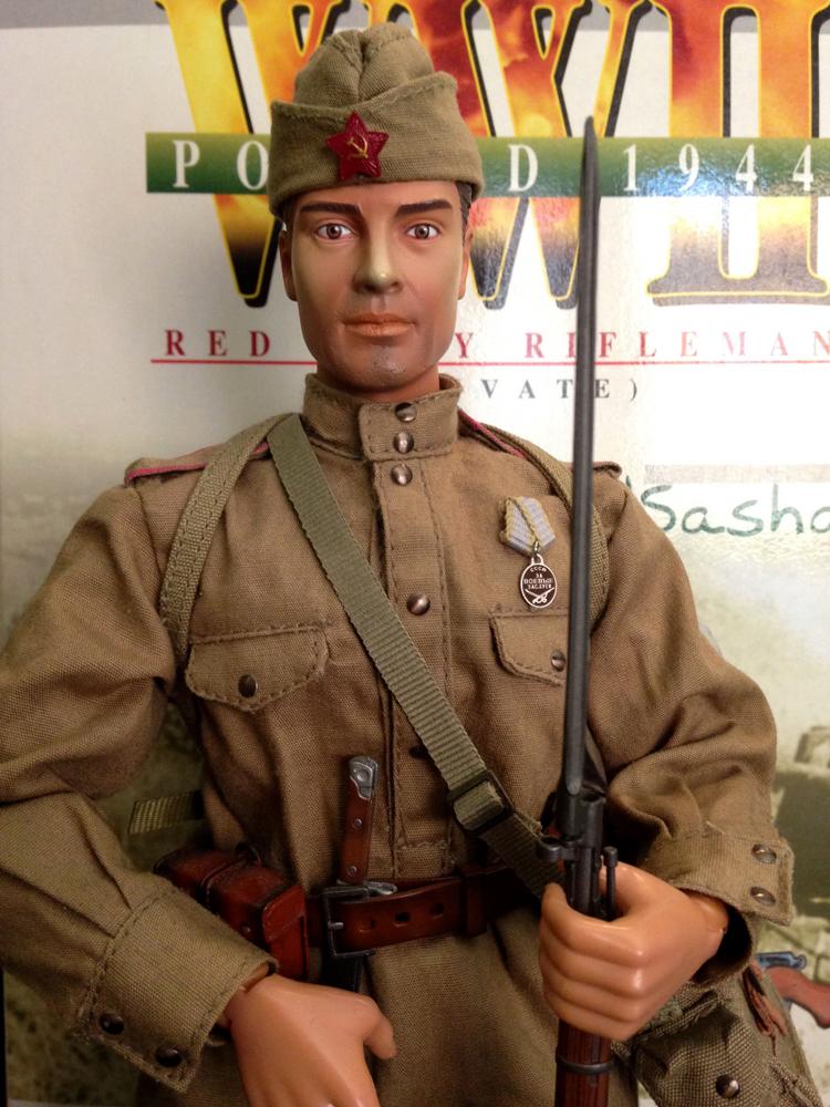 sasha holding rifle with bayonet