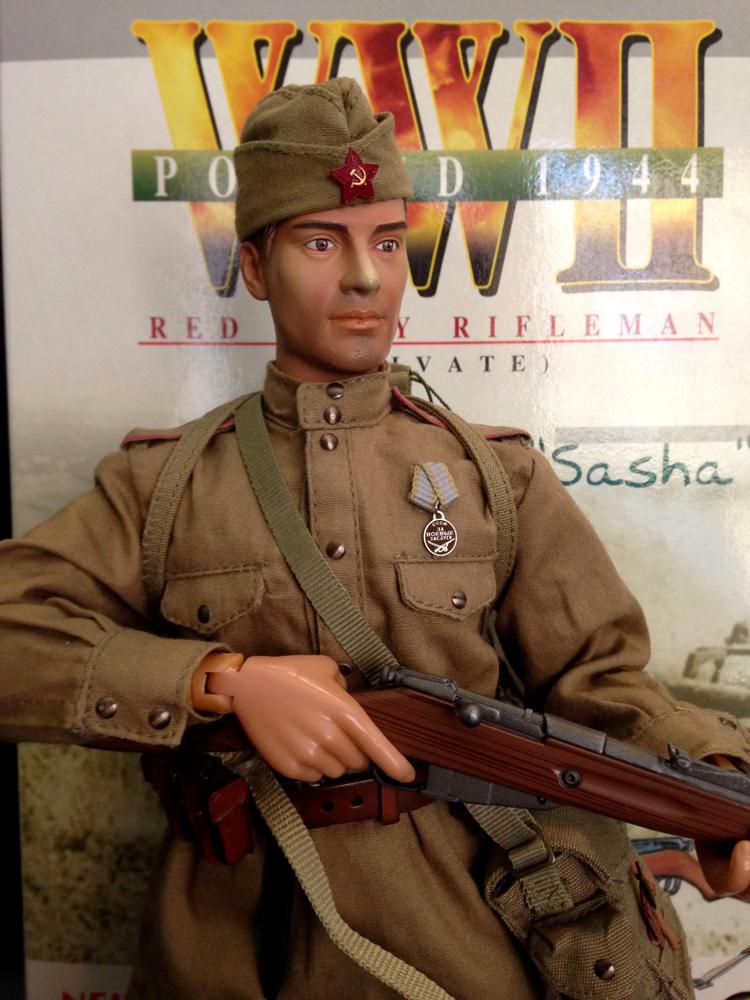 sasha posed with rifle